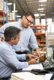 Business Colleagues Working At Desk In Warehouse Stock Images