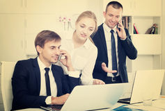 Business colleagues working and discussing on phone Stock Photography
