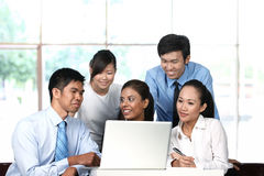 Business colleagues working on laptop Stock Photography