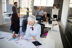 Business colleagues working in modern conference room. Business colleagues in conference meeting room during presentation royalty free stock photography