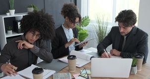 Business colleagues working on a new start up project stock footage