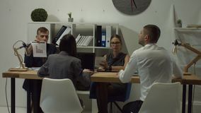Business colleagues working at open space office stock video footage