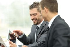 Business colleagues working with tablet computer. Stock Photos