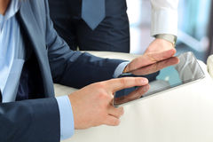 Business colleagues working together and analyzing financial figures on a digital tablet Stock Photo