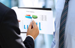 Business Colleagues Working Together And Analyzing Financial Fig Royalty Free Stock Image