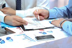 Business Colleagues Working Together And Analyzing Financial Fig Stock Photo
