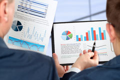 Business Colleagues Working Together And Analyzing Financial Figures On A Graphs Royalty Free Stock Photography