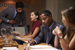 Business colleagues working together at a boardroom meeting Stock Image