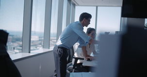 Business colleagues working together. In office. Man and woman talking about work at office desk stock video footage