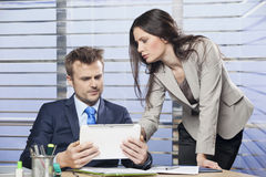 Business colleagues working together in an office. Two business colleagues working together in an office Stock Photos
