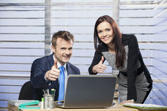 Business colleges. With thumbs up in the office royalty free stock photos