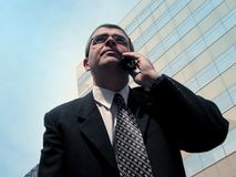 Business communication. Businessman speaking to the mobile phone in a big city Stock Images