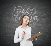 Business communication concept. Attractive asian woman on chalkboard background with speech and thought bubbles and clouds. Business communication concept Royalty Free Stock Photos