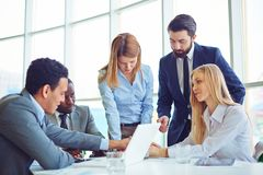 Business communication. Group of employees discussing ideas and planning work in office Royalty Free Stock Photography