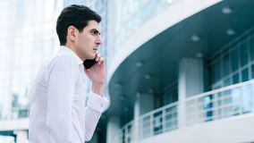 Business communication man calling busy lifestyle. Business communication. man calling his partner or client outdoors. busy lifestyle Royalty Free Stock Photo