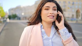 Business communication woman talk phone street. Business communication. Woman talking on the mobile phone in the street stock video