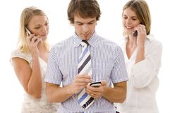 Business Communications. Three business people using technology for communication Stock Image
