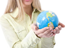 Business communications. Concept with a businesswoman holding globe stock image