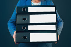 Business company accountant holding document binders. With archived paperwork and other corporate legal sheets royalty free stock photos