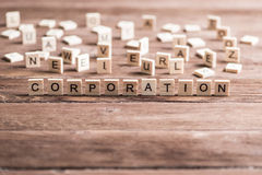Business company corporation enterprise. Business company conceptual word collected of elements of wooden elements with the letters stock photography