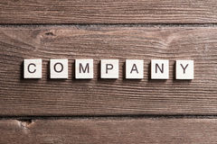 Business company corporation enterprise. Business company conceptual word collected of elements of wooden elements with the letters stock image