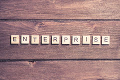 Business company corporation enterprise. Business company conceptual word collected with elements of wooden elements with the letters stock images
