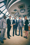 Business company. Group of successful business people looking at camera Stock Images