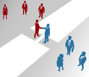 Business company teams join merger bridge 2. Two company teams join in a handshake connection over a gap Royalty Free Stock Photography