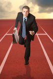 Business competition. Businessman running with a briefcase. Concept Royalty Free Stock Image