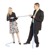 Business competition. Woman and man pull the rope Stock Photo