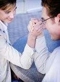 Business competition. Business man and woman arm wrestling Royalty Free Stock Photography