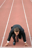 Business competition. Man running on a track & field complex to symbolize competition Stock Photography