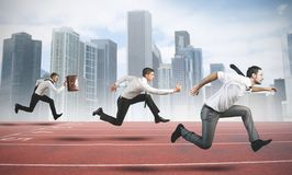 Business Competition. Concept of Business Competition with businessman that running in a track Stock Photo