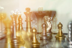 Business competition chess battle for financial victory where th. E winner gets the top of the pyramid and highest earnings.  Copy space Stock Photo