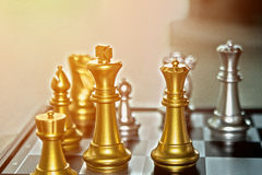 Business competition chess battle for financial victory where th. E winner gets the top of the pyramid and highest earnings.  Copy space Stock Image