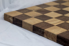 Business competition chess board concept in grainy faded old time look. Stock Photo