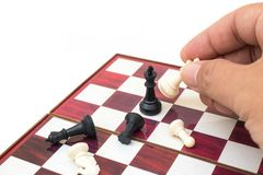Hand holding chess piece and playing chess game. Business Competition Concept : Hand holding chess piece and playing chess game stock photography