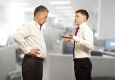 Business competition, conflict concept. Two businessman are trying to come to an agreement Royalty Free Stock Photography