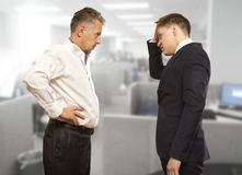 Business competition, conflict concept. Two businessman are trying to come to an agreement Stock Photography