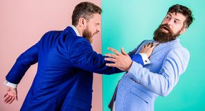 Business competition and confrontation. Domination and subordination. Hostile situation between opposing colleagues stock images