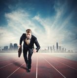 Business competition. With running businessman in the racetrack Stock Photography