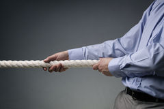 Business competition tug of war Royalty Free Stock Image
