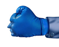 Business Competitor. And financial competitive advantage symbol with a blue boxing glove in the shape of a human head  as a leadership strategy and aggressive Royalty Free Stock Image