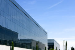 Business complex. Some buildings of a business complex. The windows are mirror type, reflecting other buildings, and a sunny and clear sky Stock Photo
