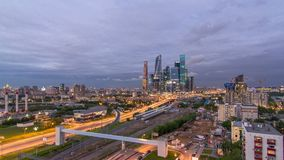 Business complex of skyscrapers Moscow city day to night timelapse. In the foreground the railway and automobile. Business complex of skyscrapers Moscow city stock video footage