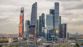 Business complex of skyscrapers Moscow city timelapse. In the foreground the railway and automobile overpass. stock video footage