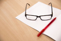 Business composition with laptop glasses and pen Royalty Free Stock Images