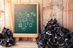 Business comunication icon on chalkboard. Drawing of business comunication icon on chalkboard background with trash crumpled paper balls on wooden floor stock image