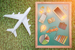 Business comunication icon with plane on grass floor. Business comunication icon on green background with plane on grass floor business concept stock photo