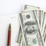 Business concept. With blank notepad pen and american dollars banknotes Stock Image